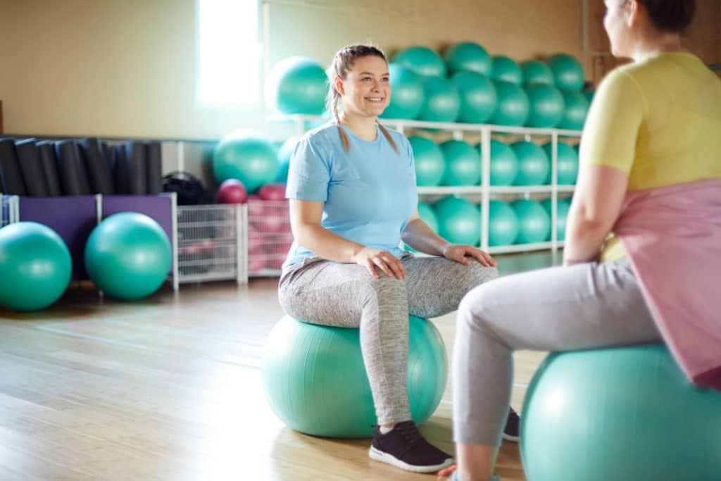 Women on Yoga ball doing pelvic floor PT