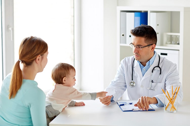 Doctor with a woman and her child - Family Medicine Manhattan New York