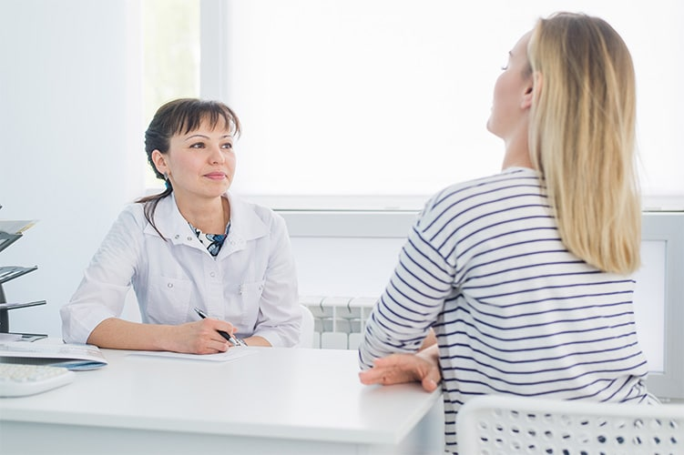 Female Patient Speaking to her Primary Care Doctor
