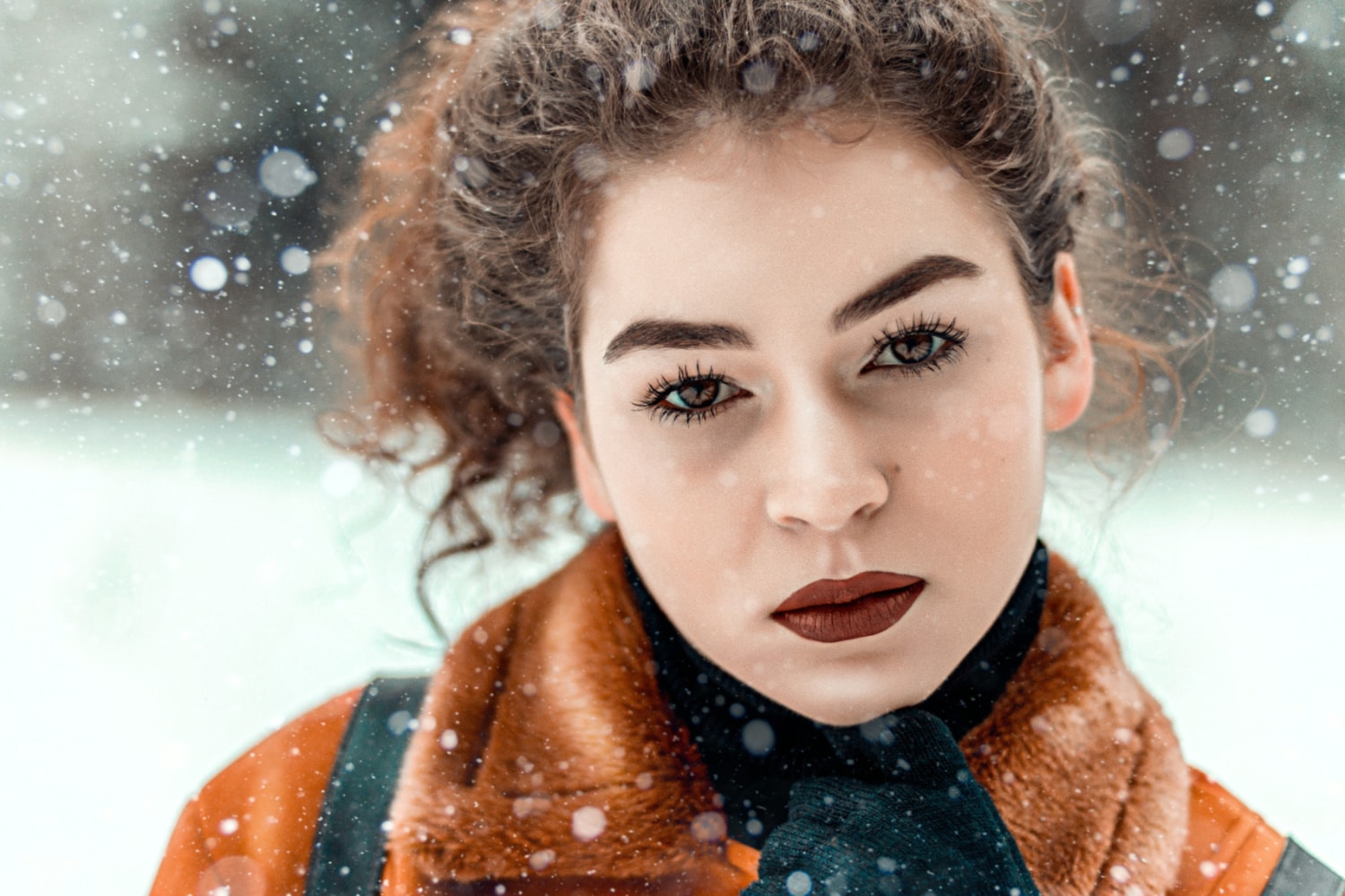 Closeup of serious woman's face with snow falling around - Skin Care Manhattan New York