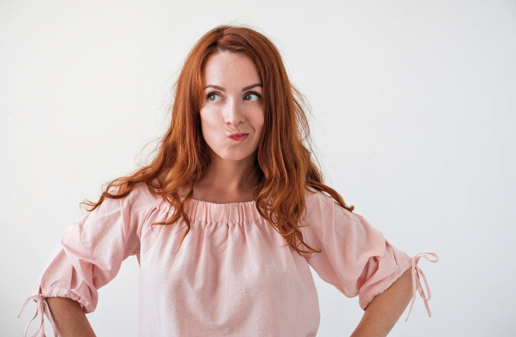 Red headed woman Concerned about missed periods