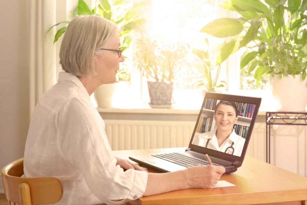 Woman using laptop to talk to doctor - Telemedicine Appointment New York