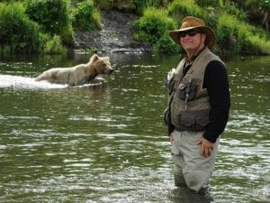 Dr. Kaufman in lake with bear in water