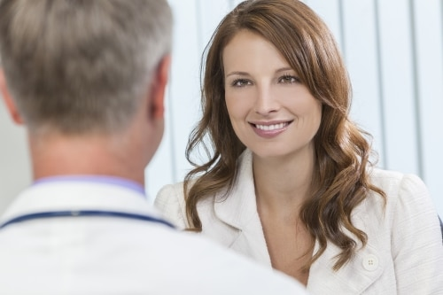 Doctor speaking to smiling patient - Gynecology Manhattan New York