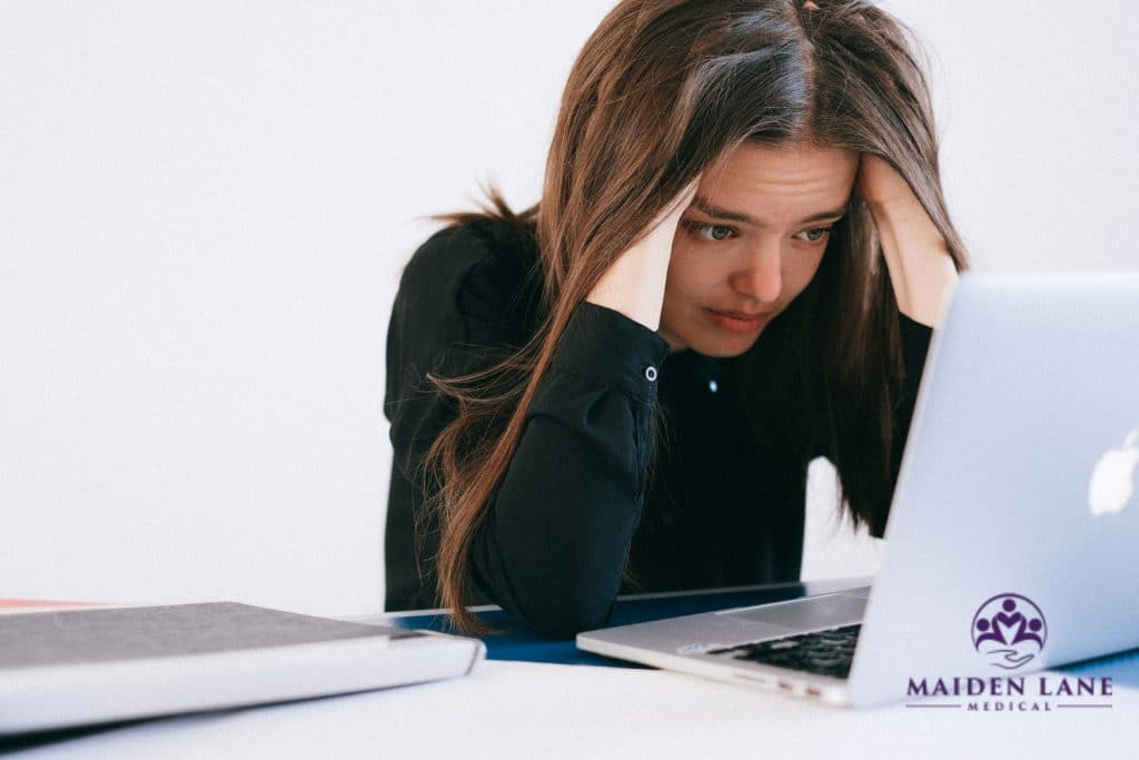 Woman looking stressed - women's mental health