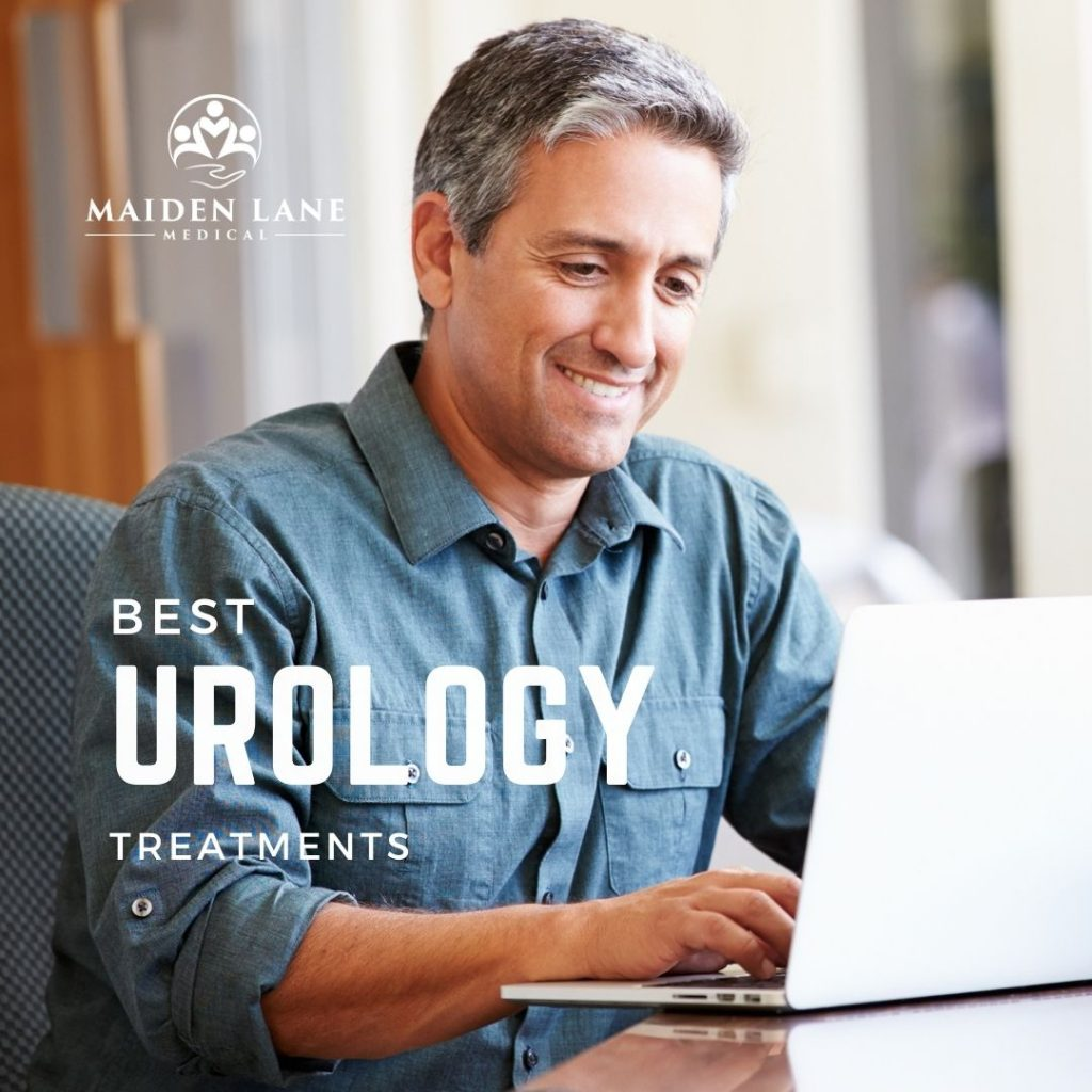 Man searching in computer for men's health urology treatments - Maiden Lane Medical, NYC