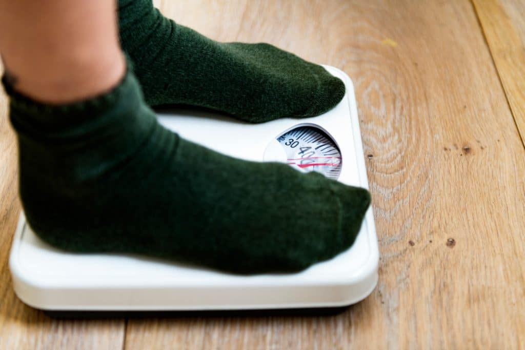 Feet on a weight scale checking for weight loss - Maiden Lane Medical, NY