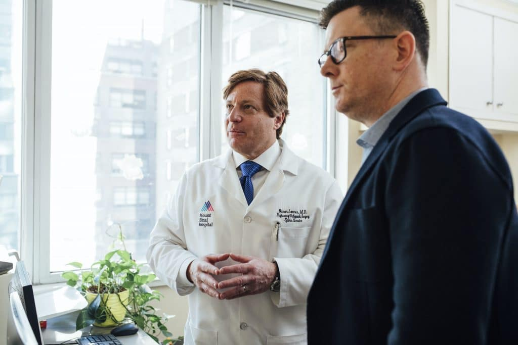 Man with his doctor discussing UTI treatment options - Maiden Lane Medical, NYC