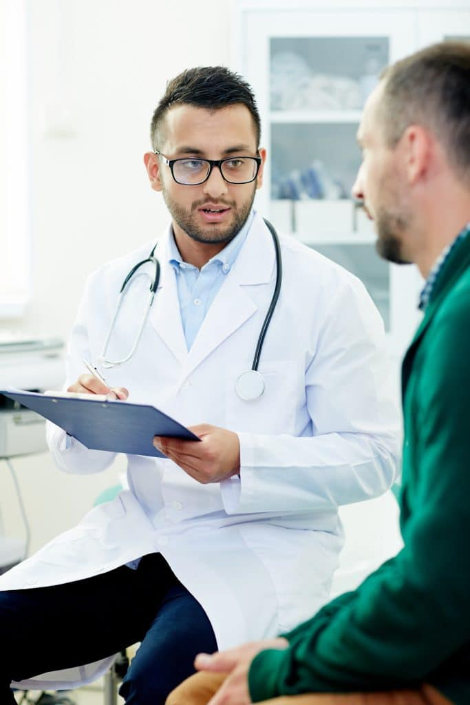 Male doctor explaining to patient treatments for HPV - Maiden Lane Medical in Midtown, NY