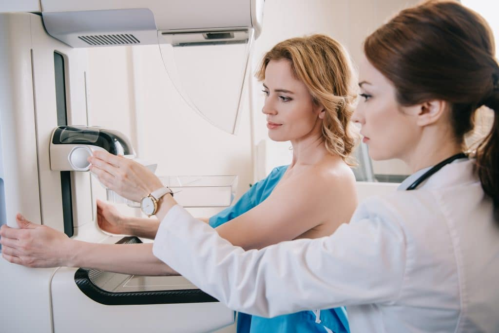 Woman receiving Screening And Diagnostic Mammography Services
