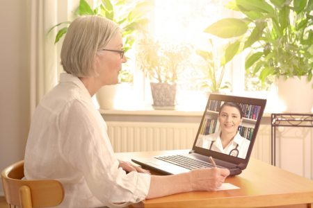 Telemedicine Available in Manhattan New York - Woman having doctor appointment using laptop