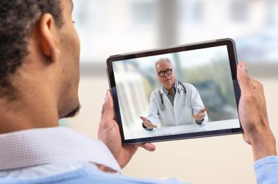 Telemedicine Manhattan New York - Man having a telemedicine appointment with doctor on tablet